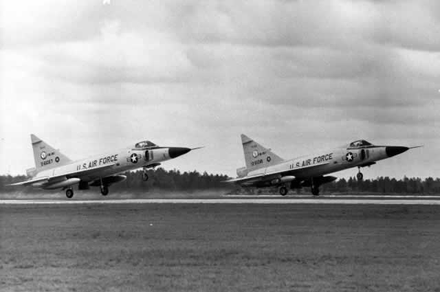Air Force F-102 Delta Dagger jet planes in tandem takeoff