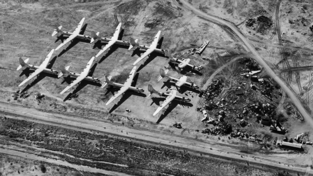 Aerial view of nine B-36 Peacemakers in various stages of being scrapped at Davis-Monthan AFB