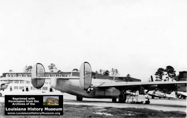 B-24 on apron at Seymour Johnson Field in WWII, hangars in background
